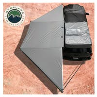 Overland Vehicle Systems 19609907 Nomadic Awning 180 - Dark Gray Cover With Black Transit Cover & Brackets